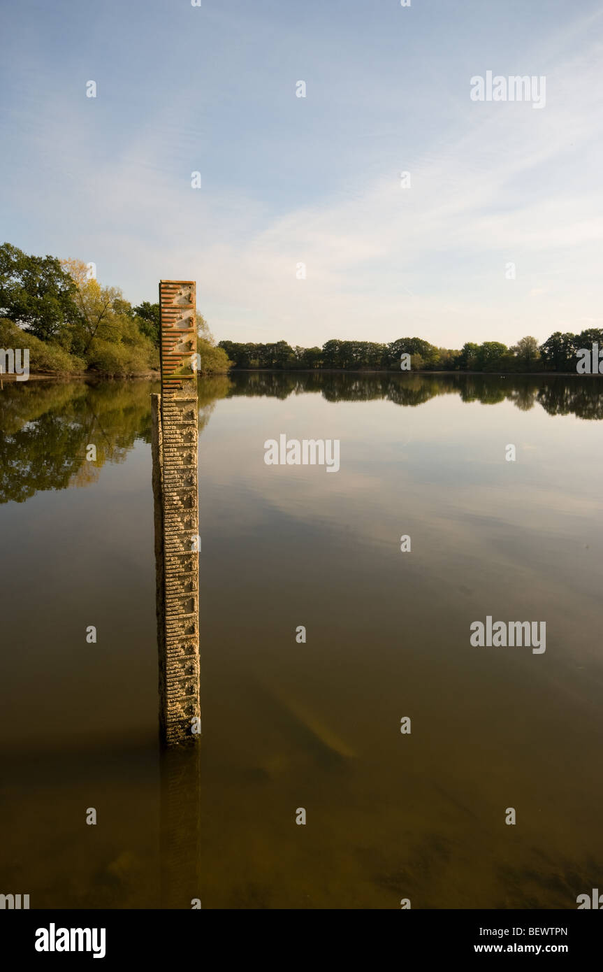 A water level measure shows the extent of the water shortage in a reservoir in Northamptonshire. Stock Photo