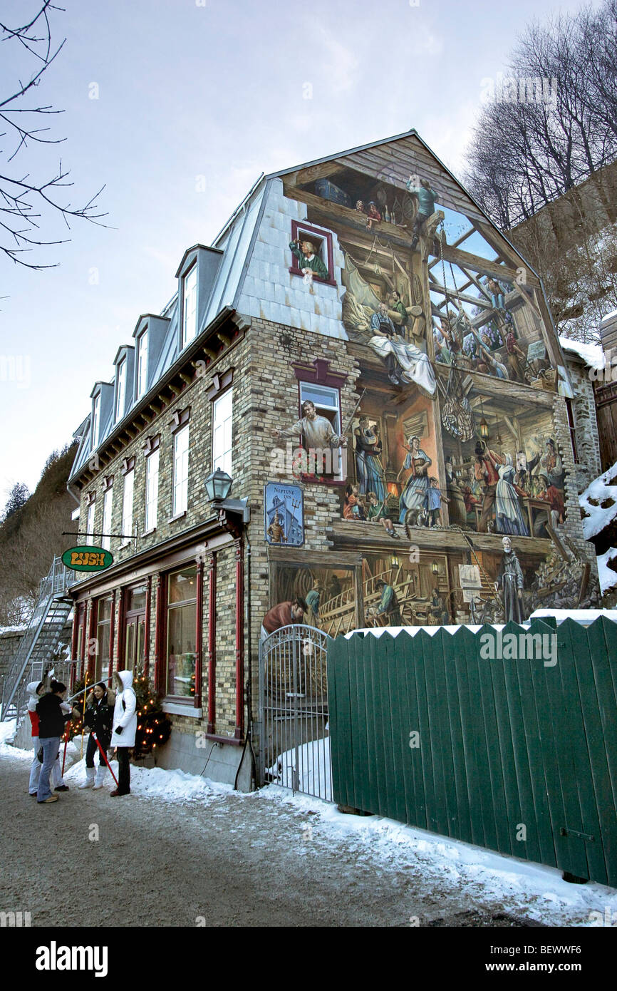 Building in Old Town of Quebec City with 'trompe l' oeil' painting which translates to 'fool the - Stock Image