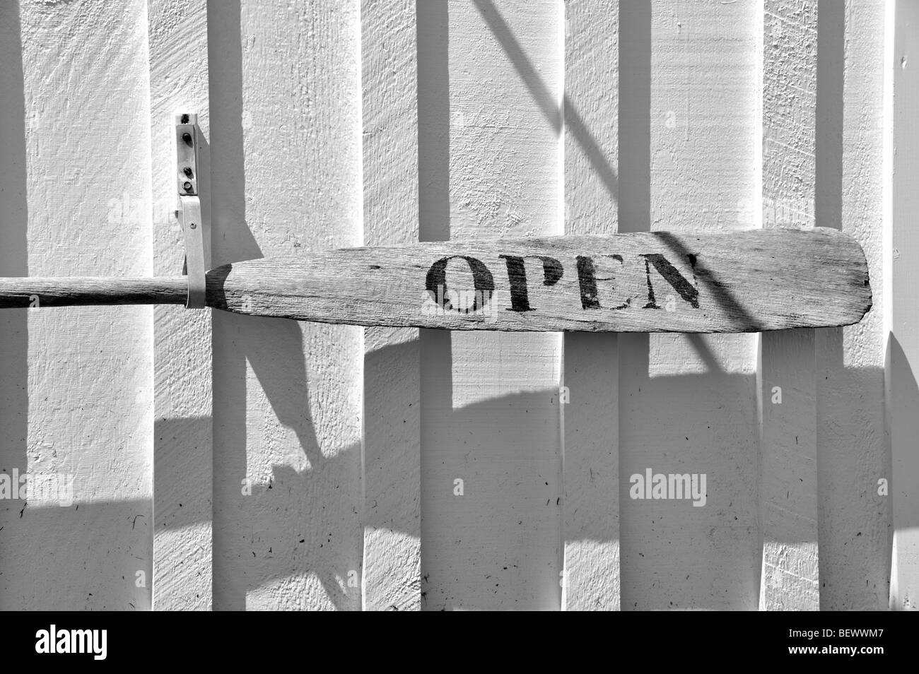 Open sign made from a wooden oar hangs outside the Marshall Point Lighthouse Museum, Port Clyde, Maine, USA. - Stock Image