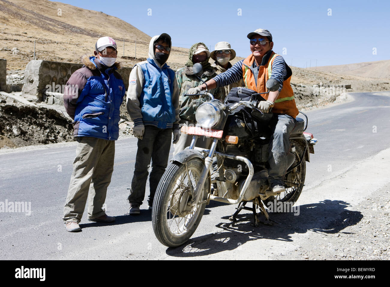 A few Tibet people with a motorbike in shot/ - Stock Image