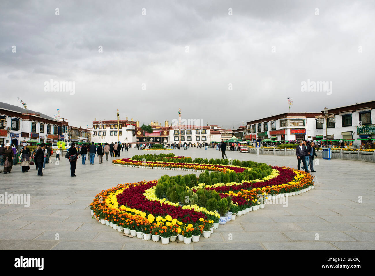 Square in Tibet, rows of flowers. - Stock Image