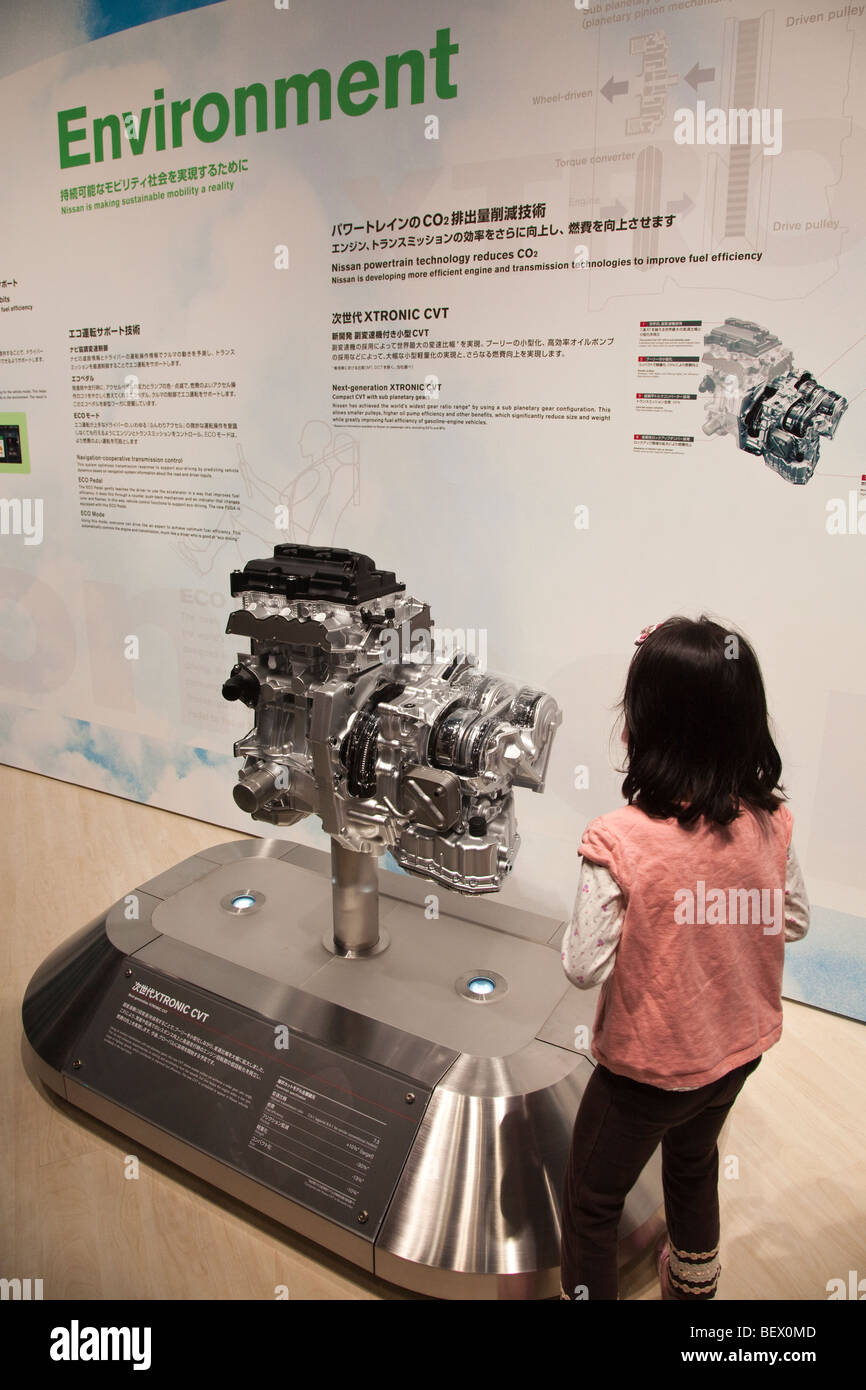 Participants learning about non-emission electric vehicles at the Tokyo Motor Show. - Stock Image