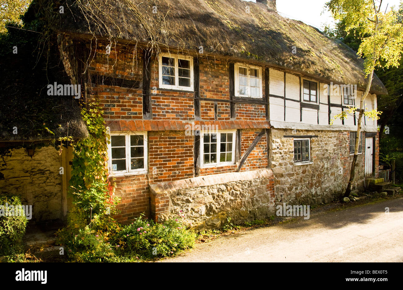 Typical English timber framed thatched cottage in Ogbourne St.Andrew a country village in Wiltshire, England, UK - Stock Image