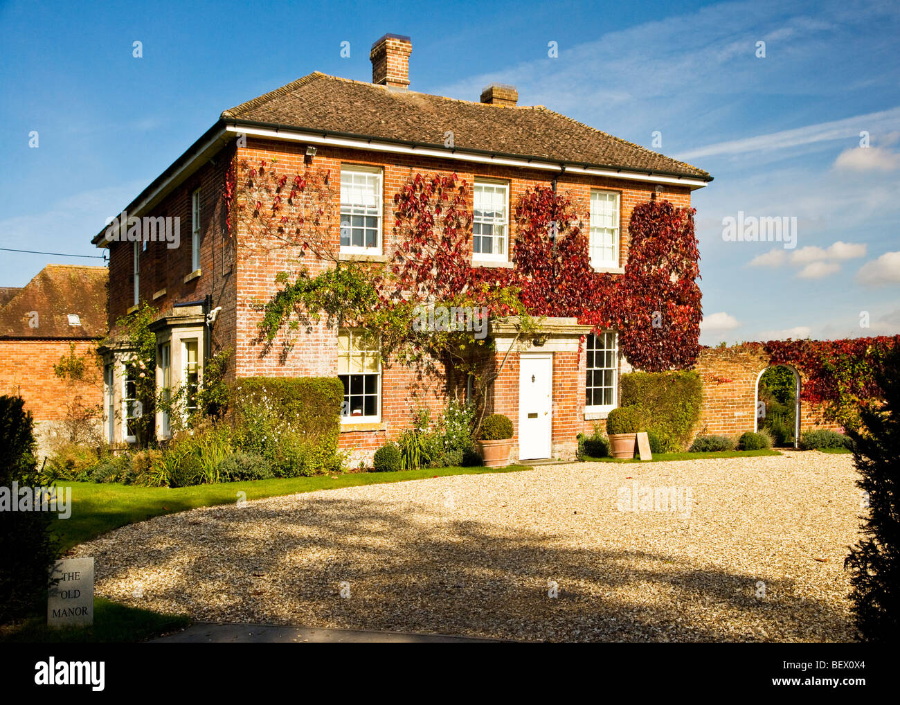 Typical English country manor house in Ogbourne St.Andrew a village in Wiltshire, England, UK - Stock Image