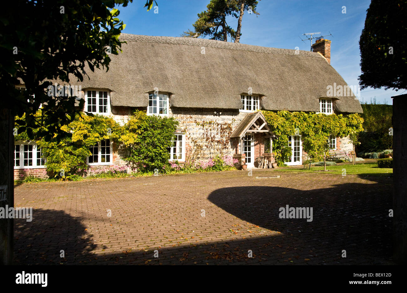Typical English thatched stone country village cottage in Ogbourne St.George in Wiltshire, England, UK - Stock Image