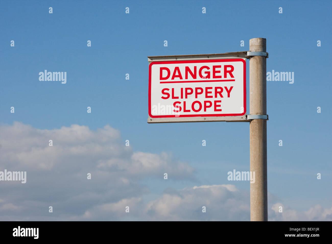 Danger Slippery Slope sign - Stock Image