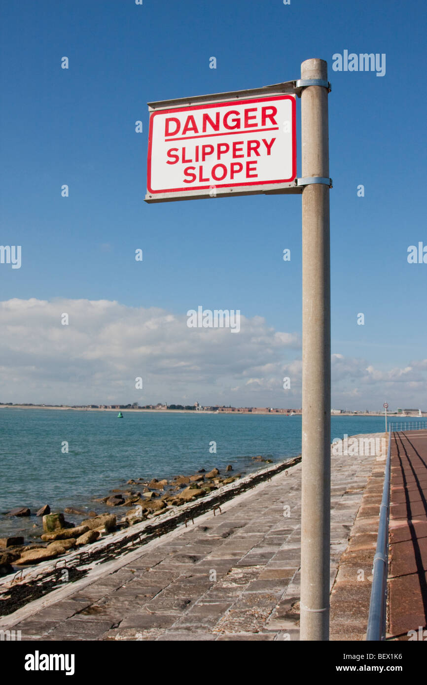 Danger Slippery Slope sign by the sea front in England, UK. - Stock Image