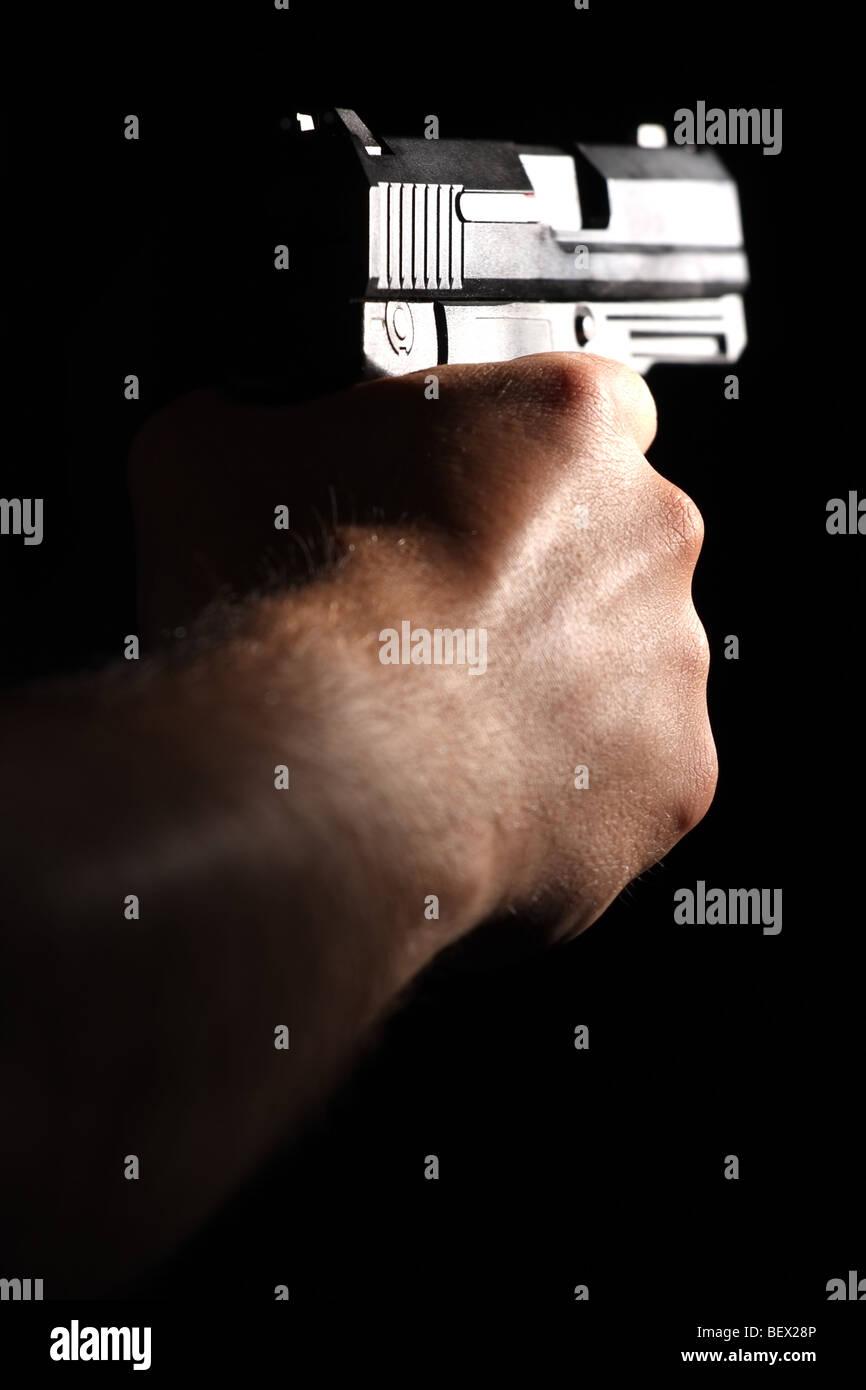A man tacking aim. - Stock Image