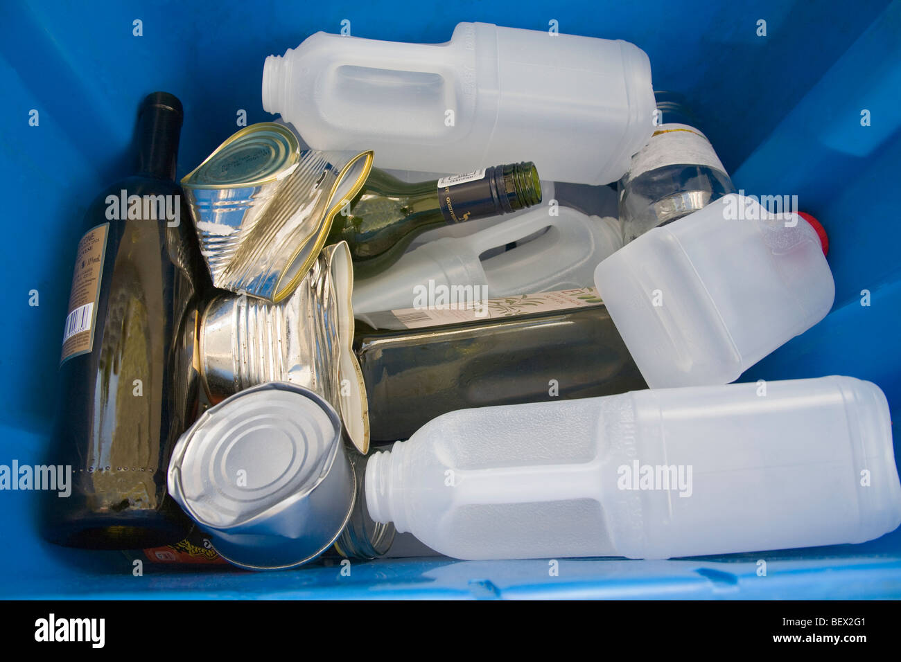 Studio Close up Local authority plastic box filled with glass tins and plastic milk bottles for recycling - Stock Image