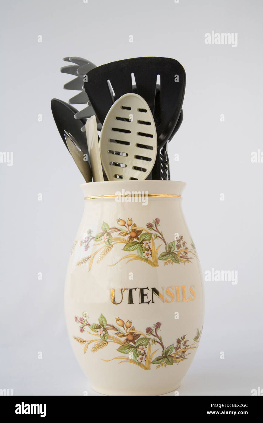 Studio close up Ceramic pot holding a selection of kitchen utensils - Stock Image