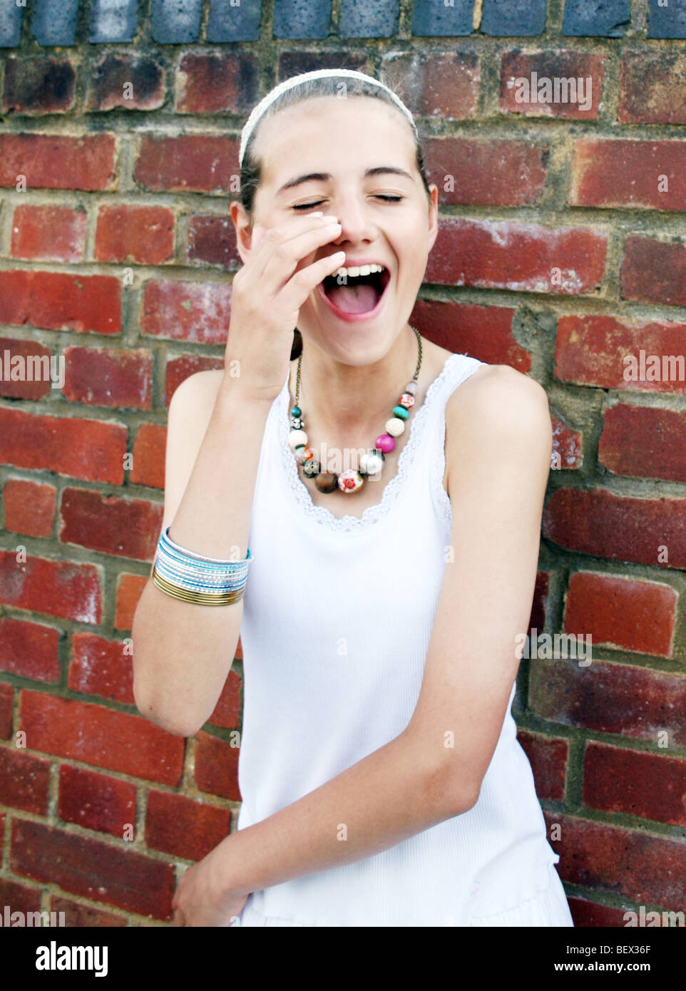 girl crying with laughter - Stock Image