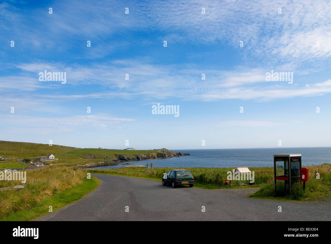 Telephone kiosk and post box outside the only grocerie store on the island of Fetlar in the Shetland Islands - Stock Image