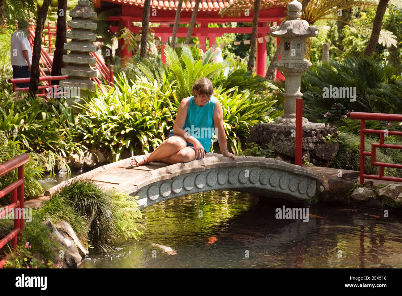 A woman tourist in the Japanese garden, Monte Palace gardens, Monte, Funchal, Madeira - Stock Image