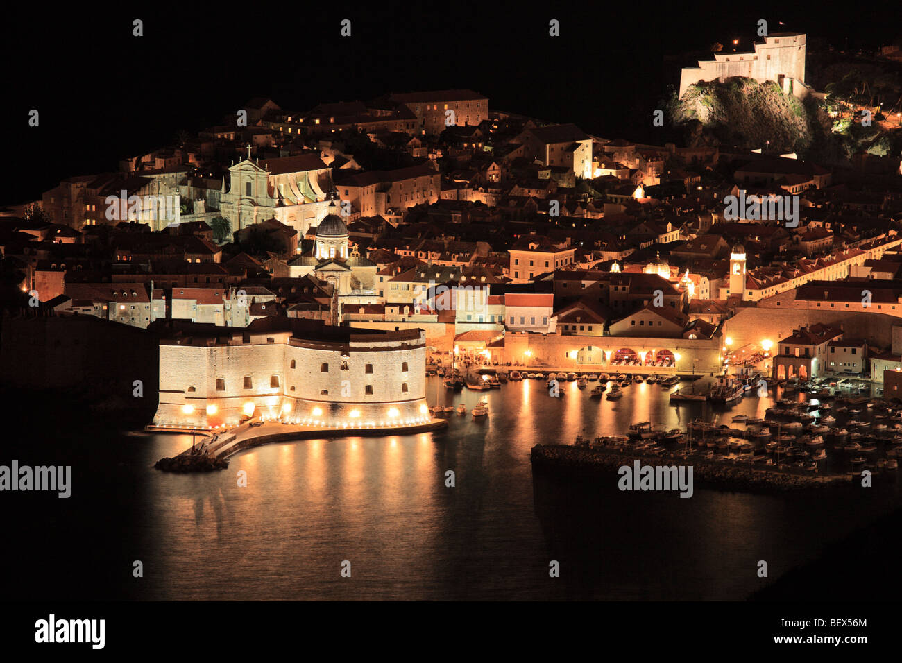 A panorama of an old city of Dubrovnik by night, Croatia - Stock Image