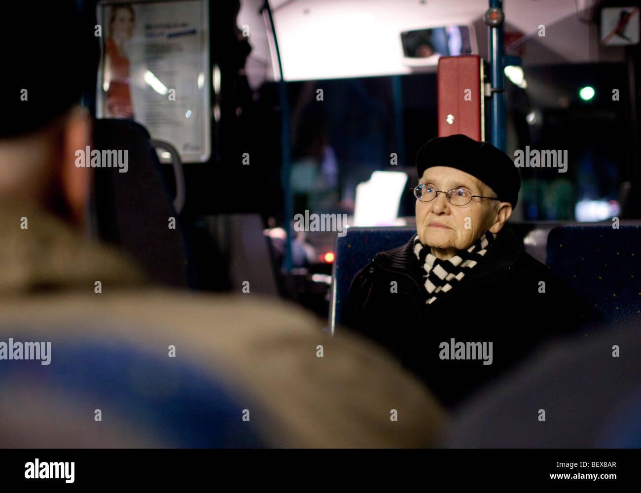 Senior in public bus . Stock Photo