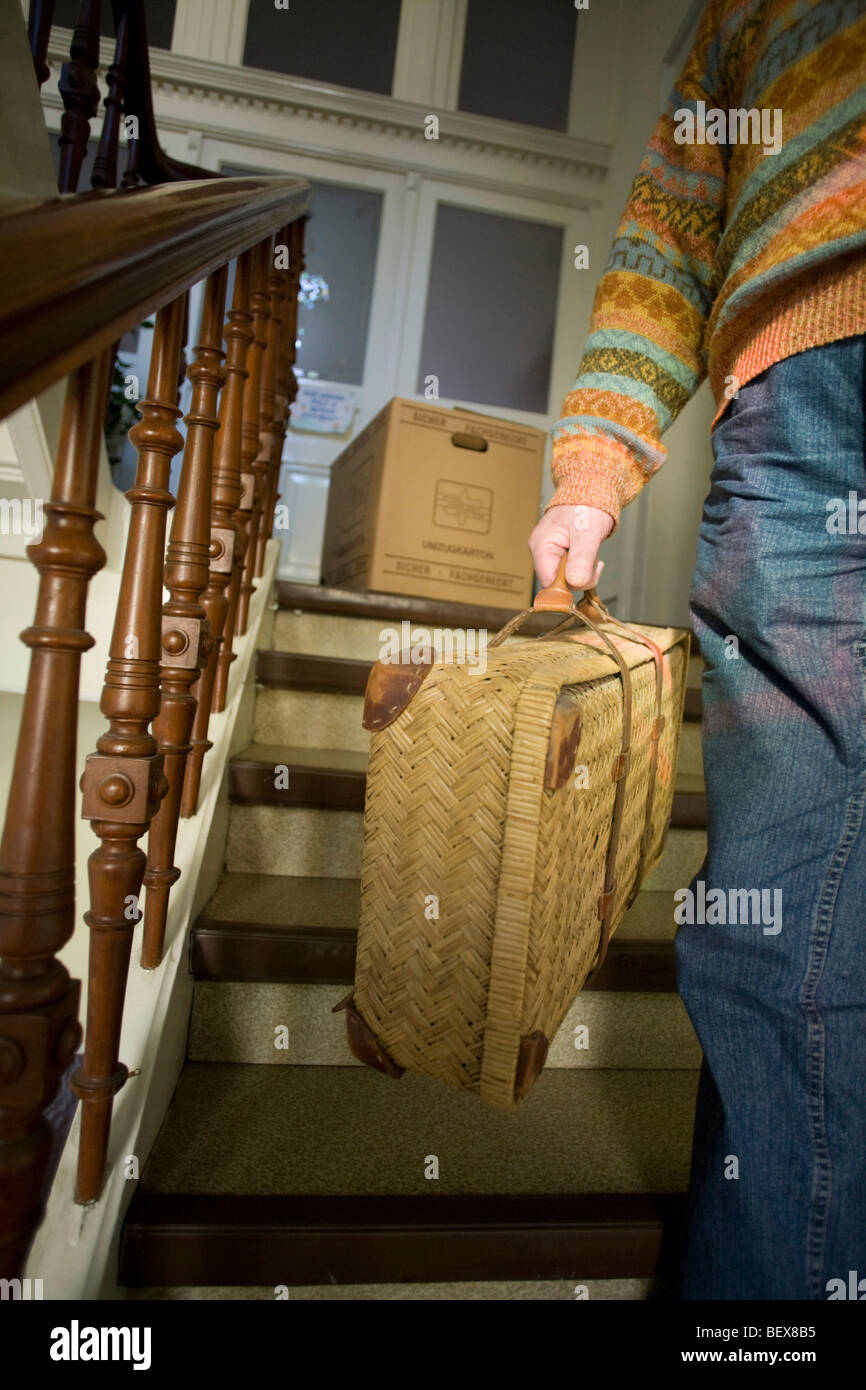 Senior carries a suitcase. Stock Photo