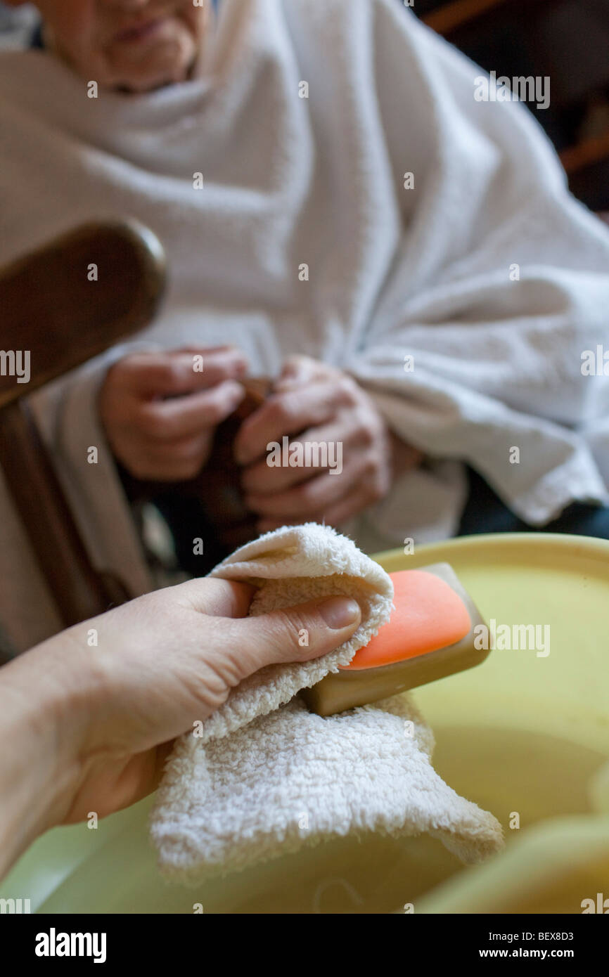 Care for elderly, Daughter is washing her mother - Stock Image