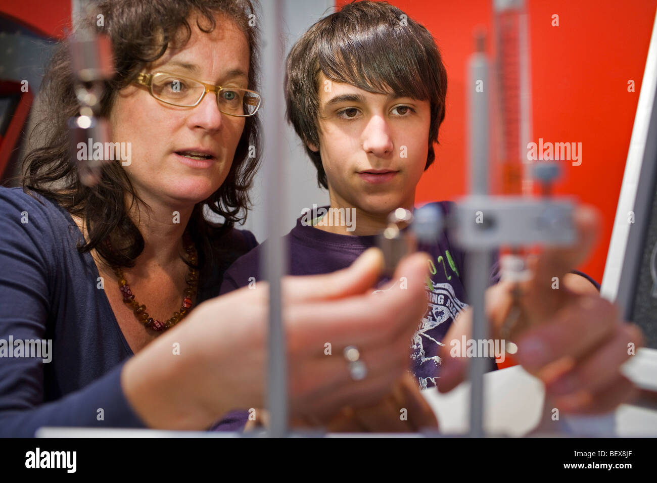 Student and teacher at physics class . - Stock Image