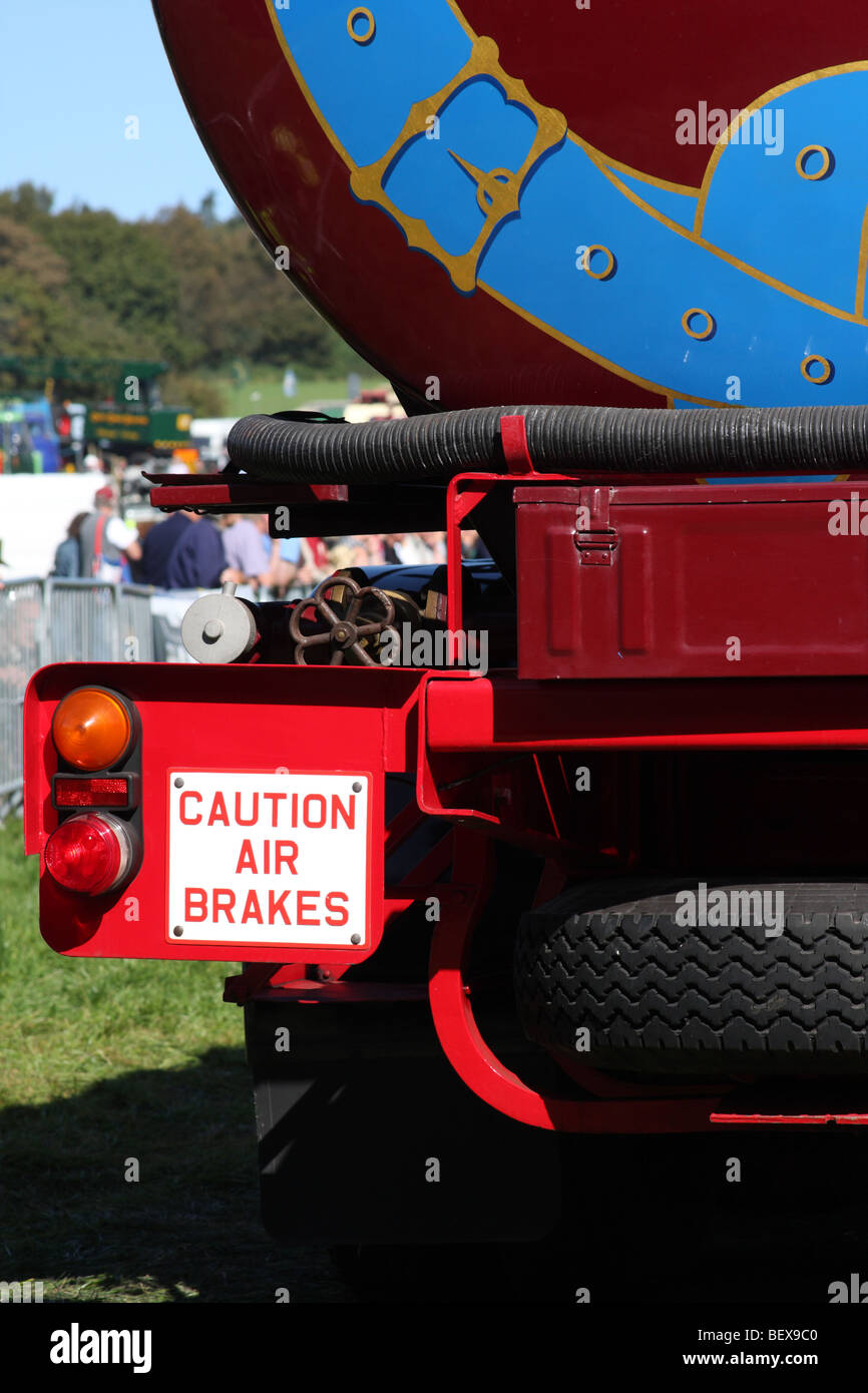An air brakes warning sign on the rear of a HGV. - Stock Image