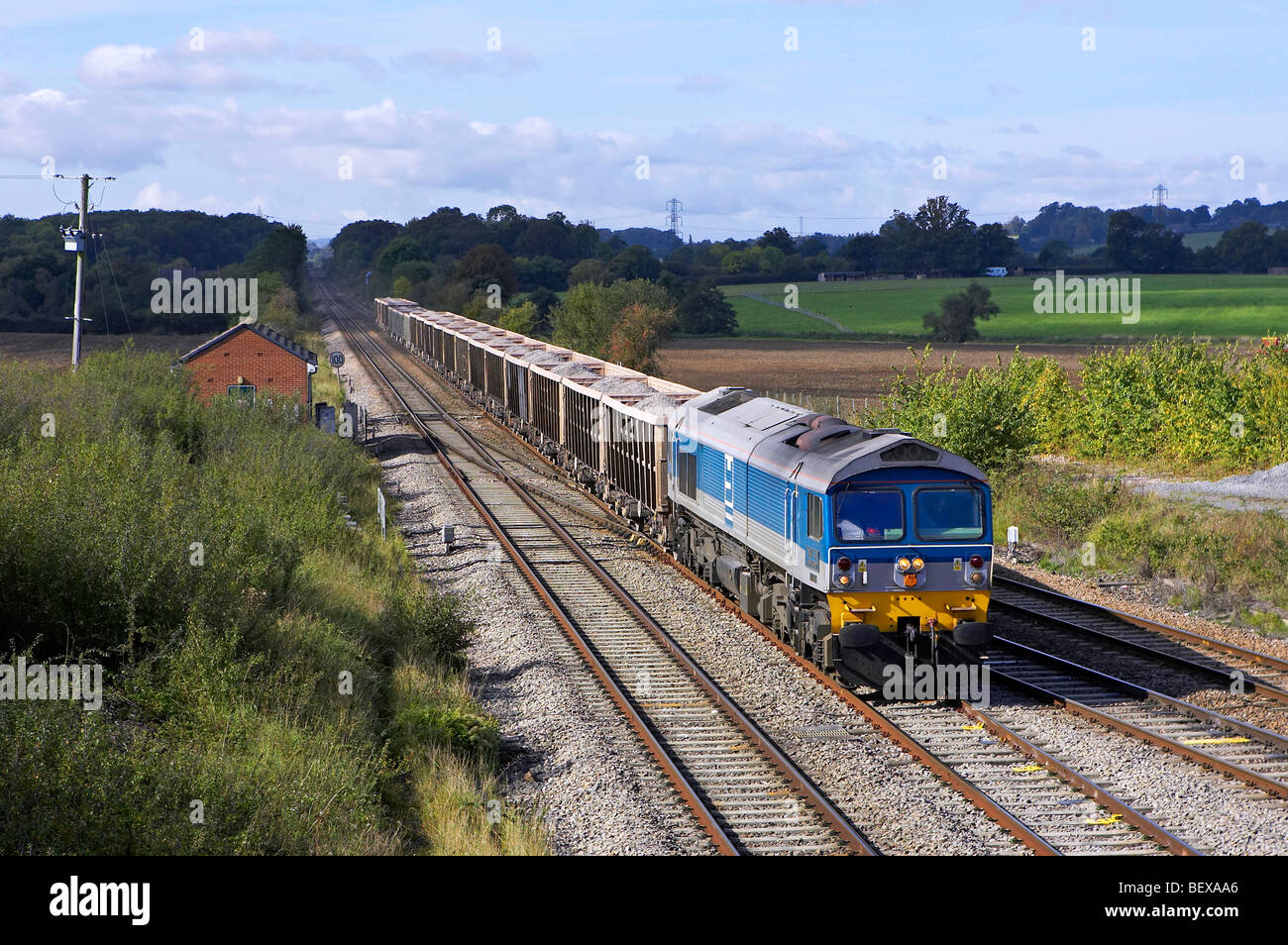 Aggregate Industries (Foster Yeoman) 59004 'Paul A Hammond' passes over Fairwood Junction (Westbury) with - Stock Image