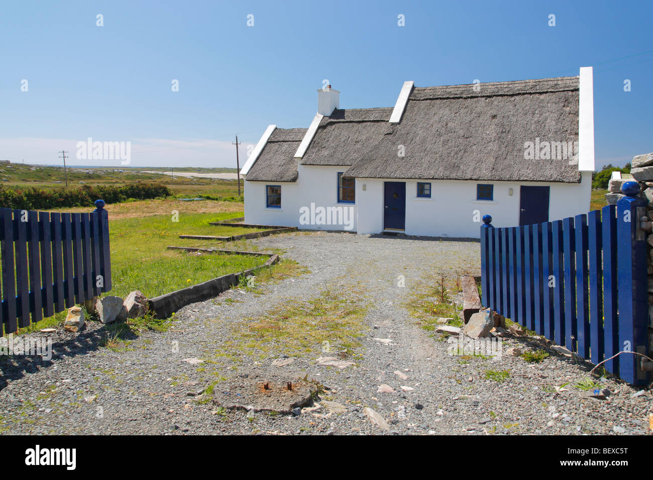 thatched cottage in Claddaghduff used as an holiday home, Connemara Ireland - Stock Image