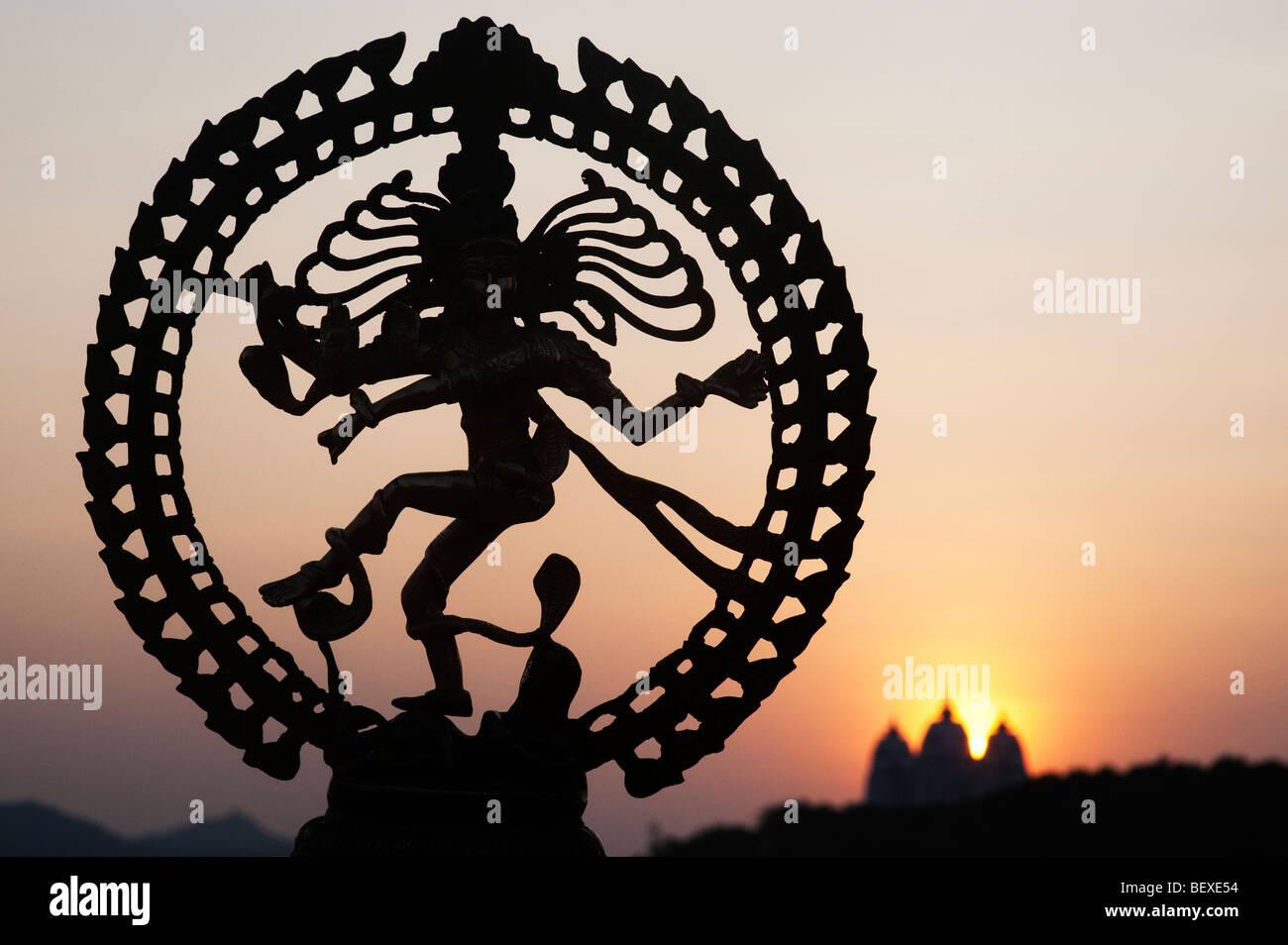 Dancing lord Shiva statue, Nataraja silhouette, against an ...