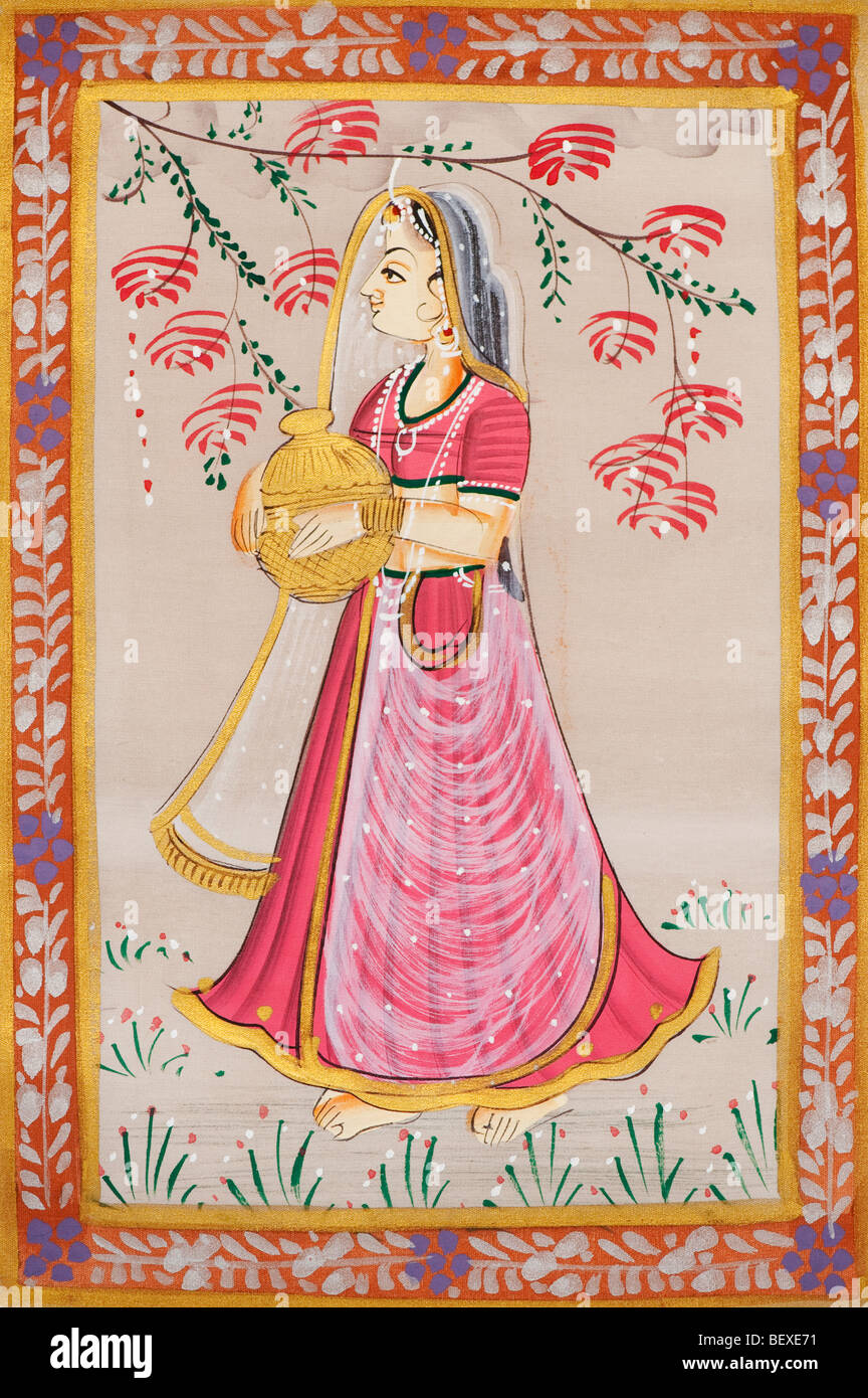 Traditional Indian silk painting of an Indian woman Gopi carrying a pot - Stock Image