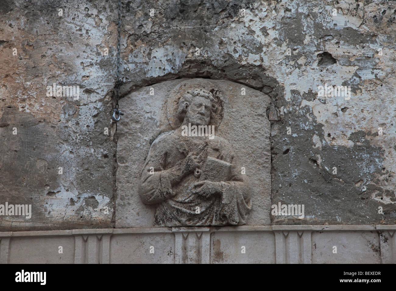 Frieze on wall of Church of All Saints on island of Korcula, Croatia - Stock Image