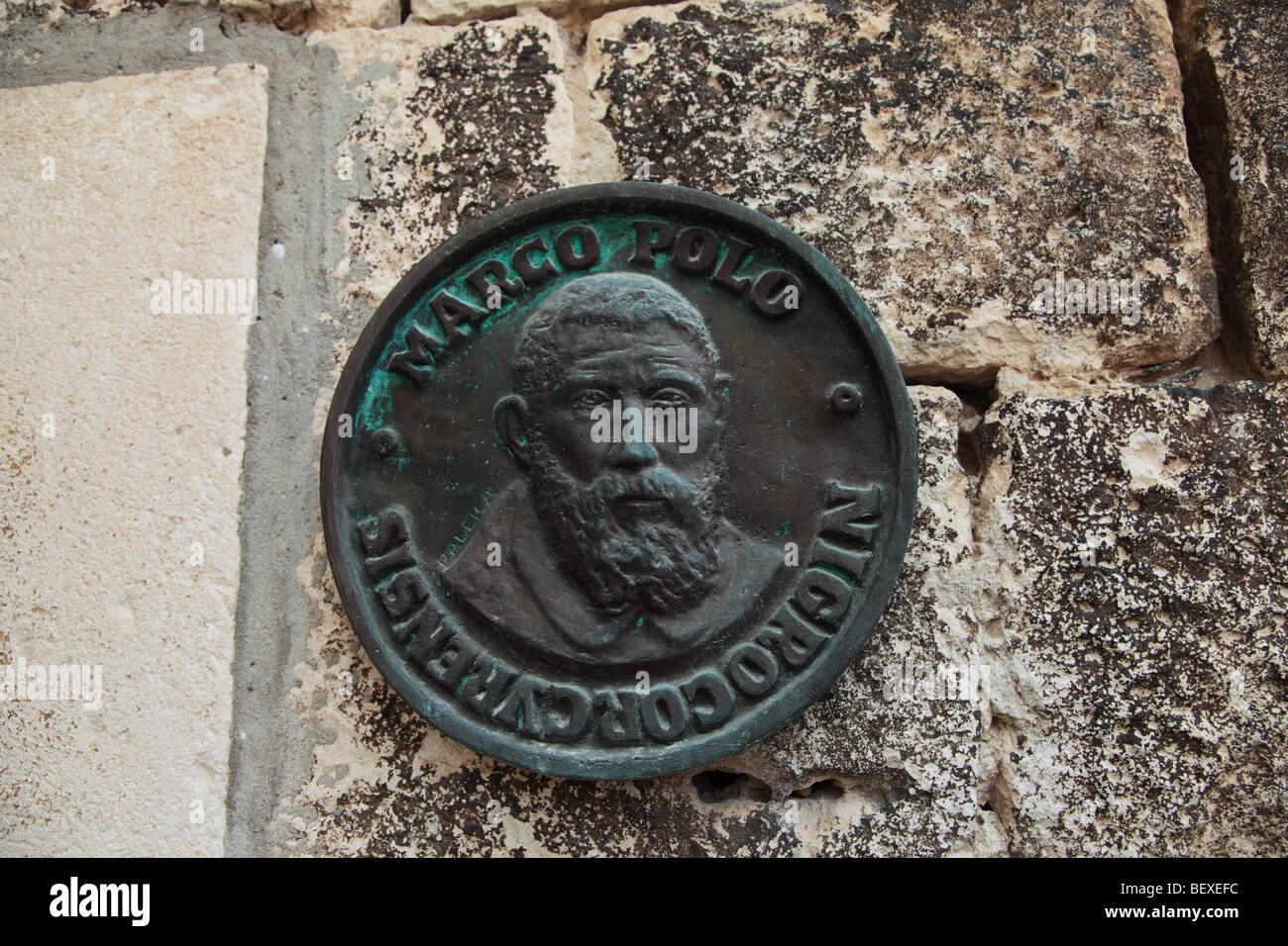 Plaque on wall of Marco Polo House on island of Korcula, Croatia - Stock Image
