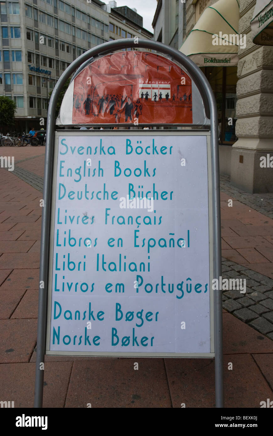 Sign advertising books in many languages at Stureplan square in Stockholm Sweden Europe - Stock Image
