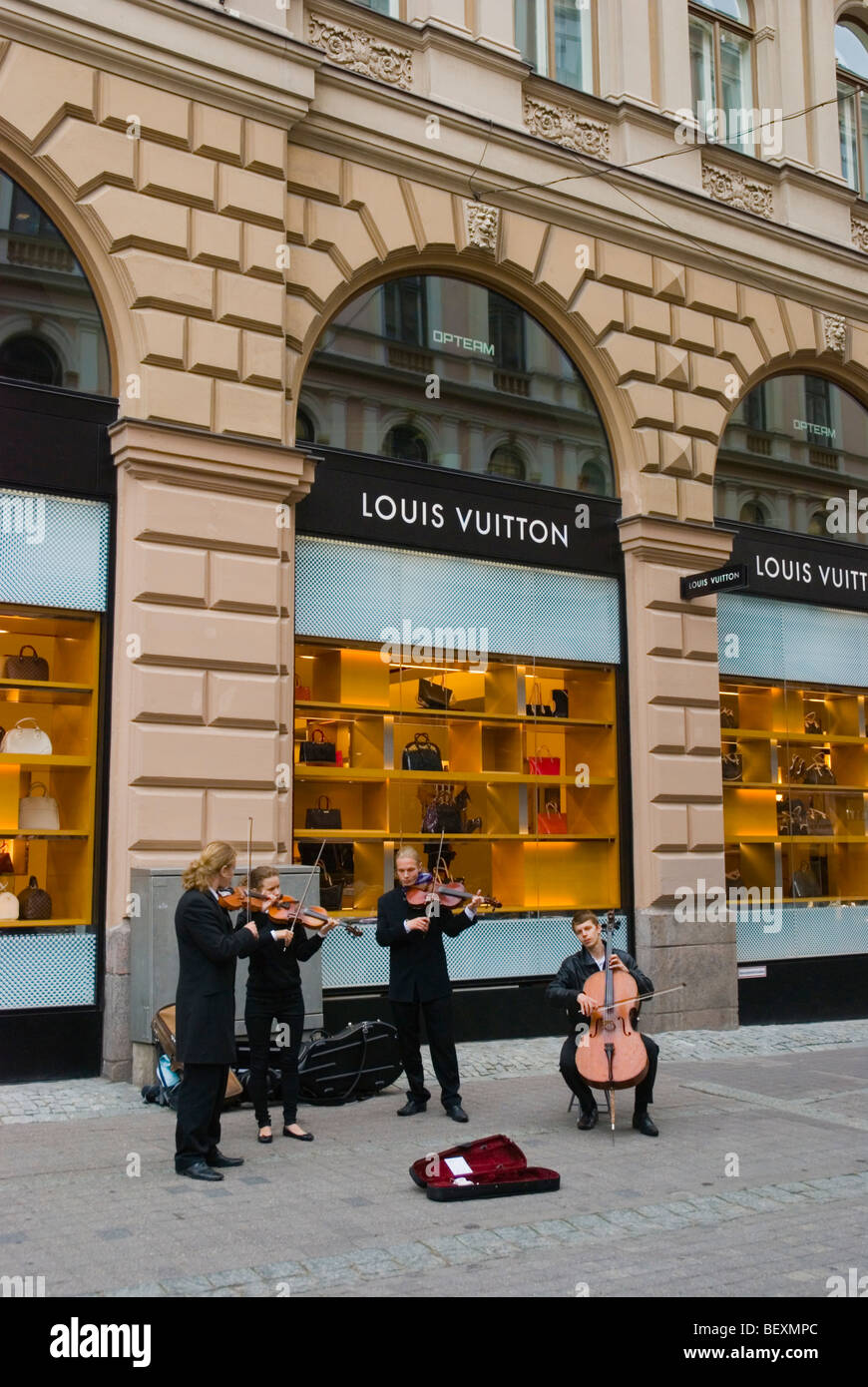 Classical music buskers in front of Louis Vuitton store in central Helsinki Finland Europe - Stock Image