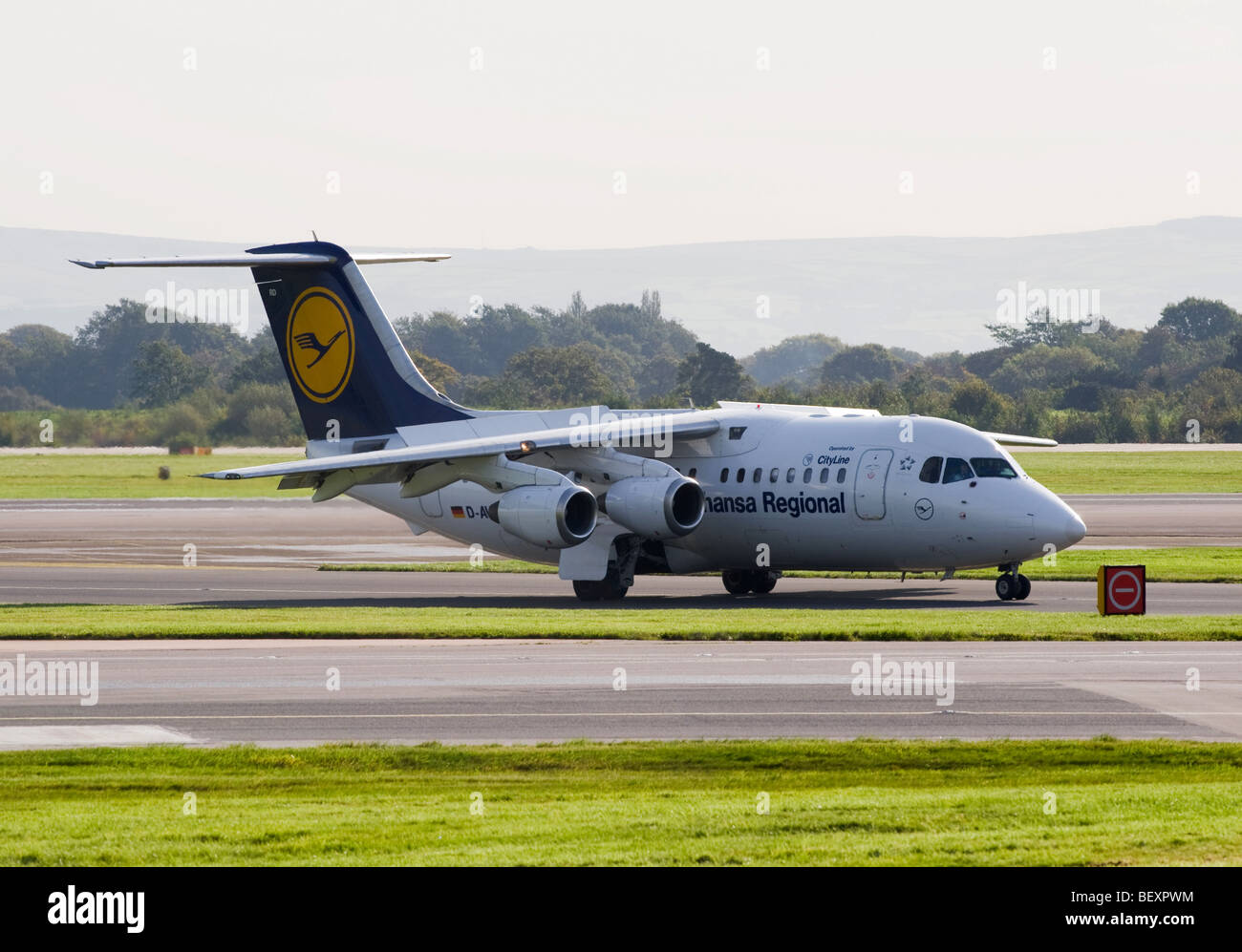 Lufthansa CityLine Avro RJ85 Cityliner Airliner D-AVRD Taxiing at Manchester International Airport England United - Stock Image