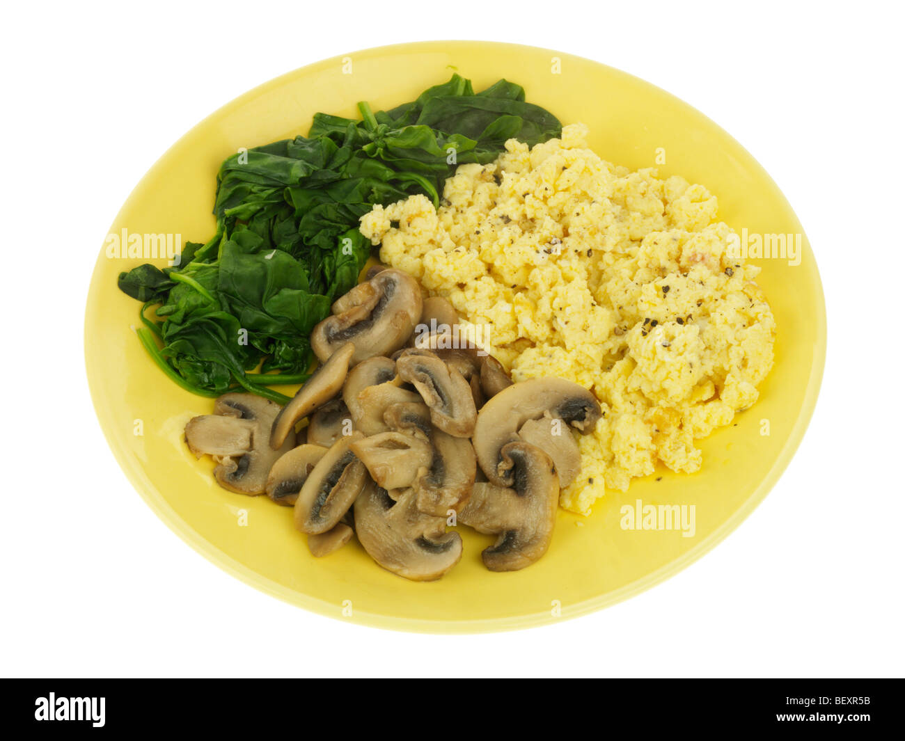 Scrambled Egg with Mushrooms and Spinach - Stock Image