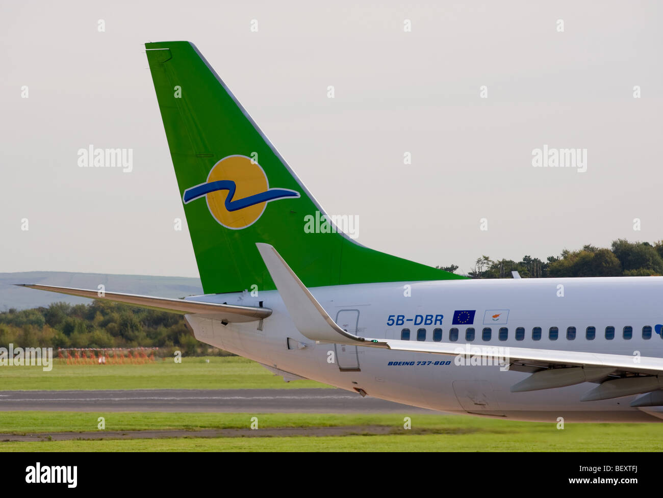 Tail of Eurocypria Airlines Boeing 737-8Q8 [Winglets] Airliner 5B-DBR Taxiing at Manchester International Airport - Stock Image