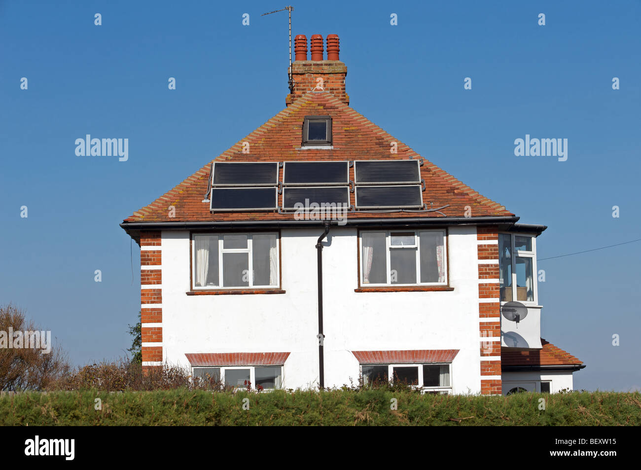 House with solar energy panels fitted to the roof - Stock Image