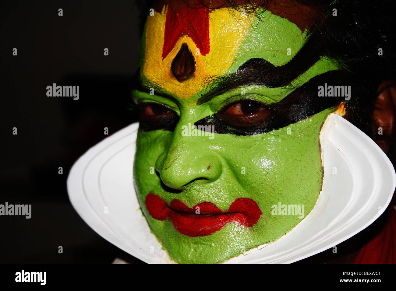 Kathakali ,Malayalam,is a highly stylised classical Indian dance-drama noted for its attractive,greenish face,painted - Stock Image