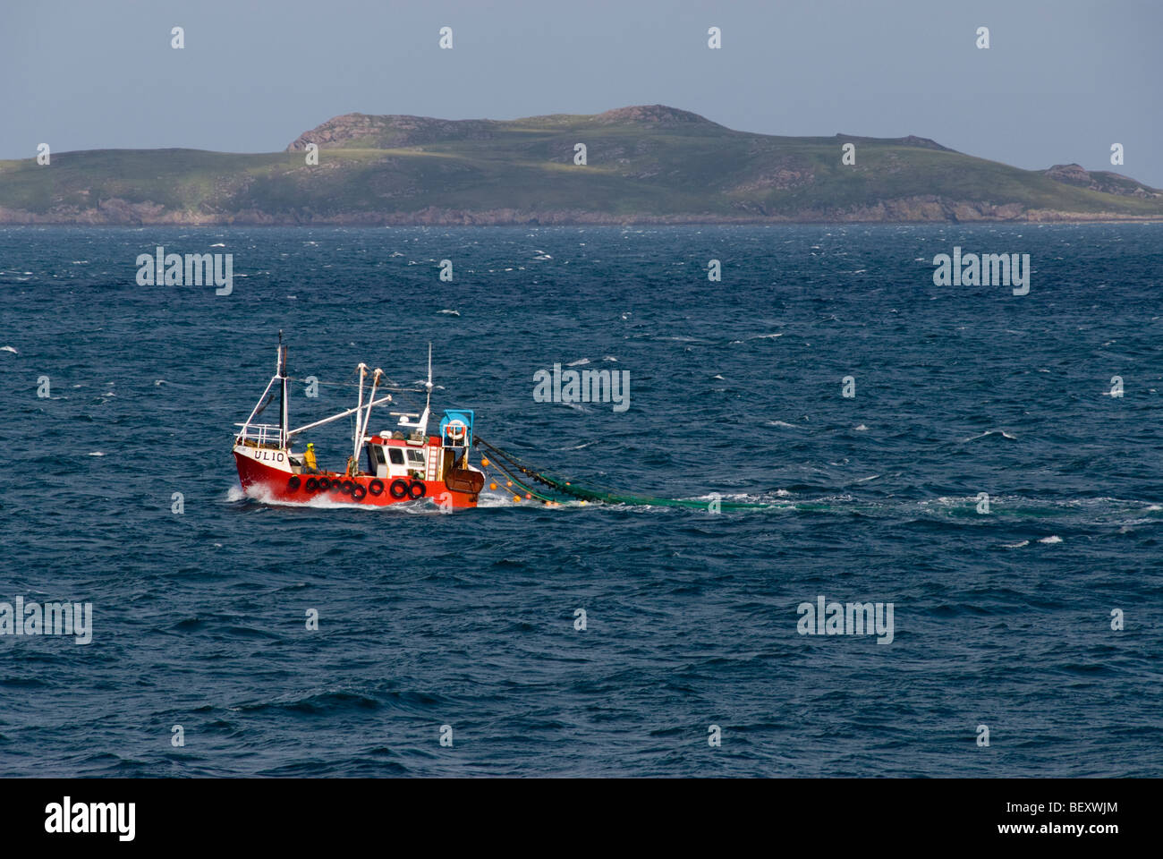 Fishing boat pulling net in the Minch near Ullapool, Scotland Stock Photo
