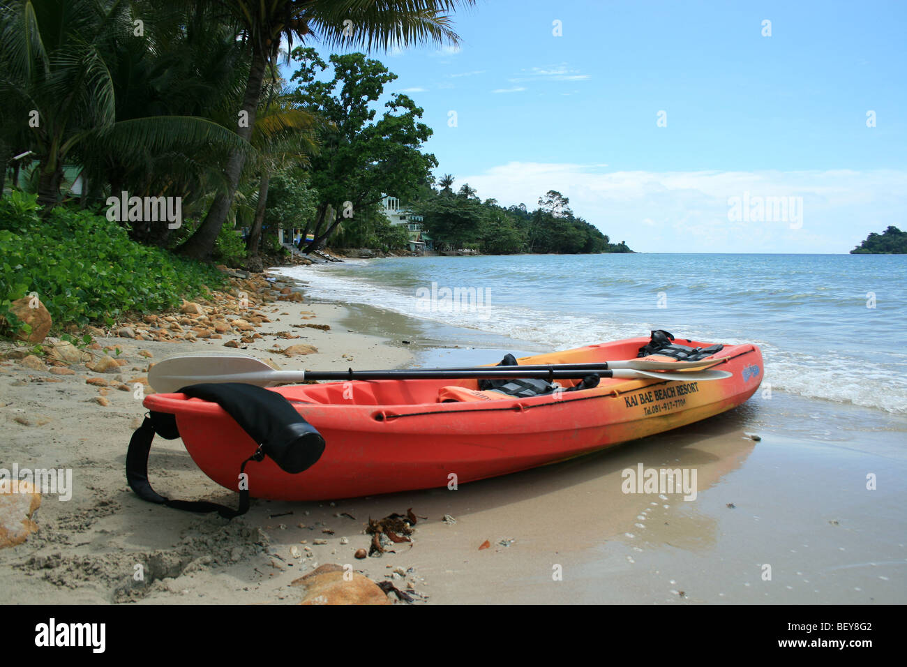 Kayak on a beach in Koh Chang, Thailand. - Stock Image