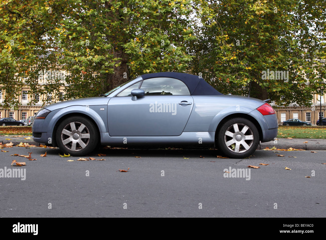 Audi TT Roadster soft top sports car parked among Autumn leaves at The Circus in Bath England October 2009 - Stock Image