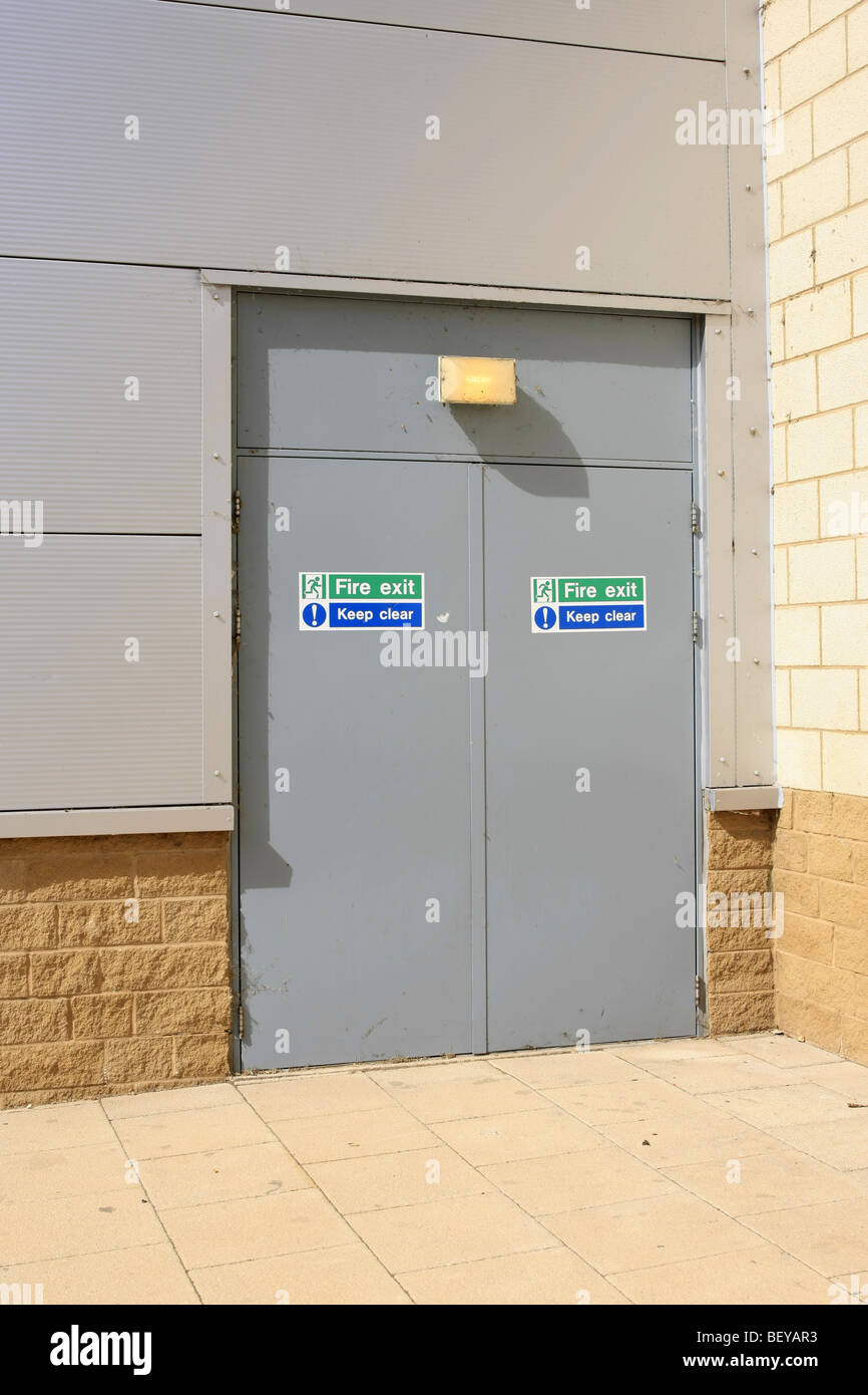 Fire exit door at the back of a building Stock Photo