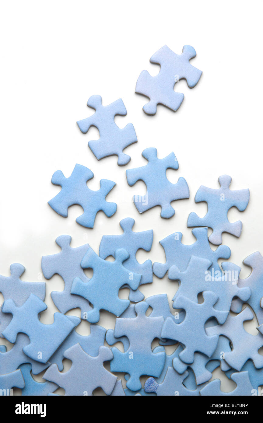 Jigsaw puzzle with pieces spread out on white - Stock Image