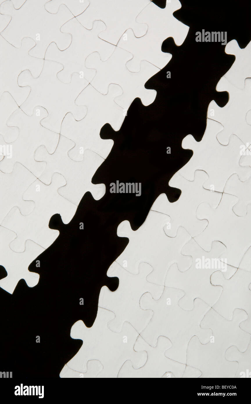 Jigsaw puzzle with pieces missing through the center - Stock Image