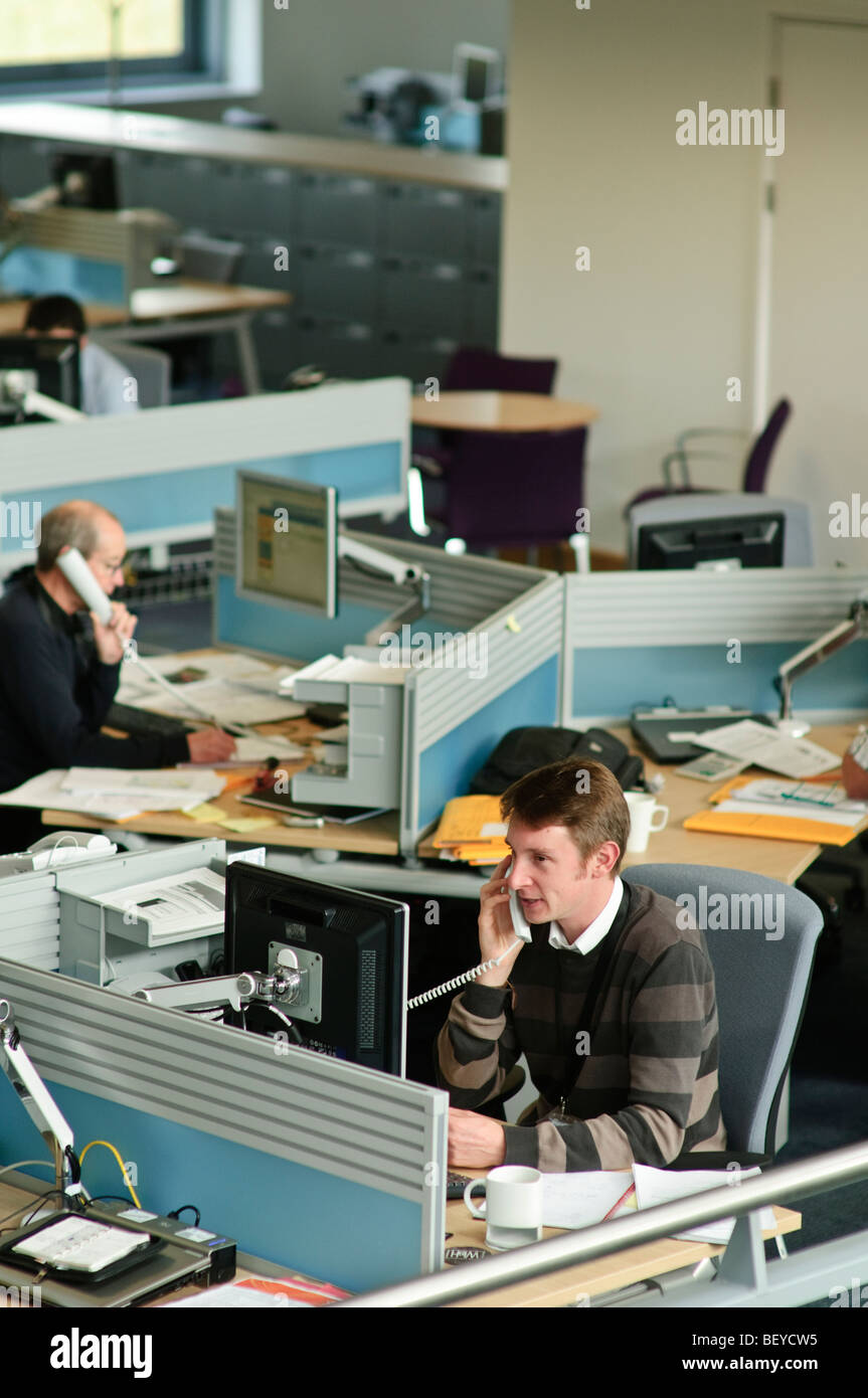Welsh civil servants working in open plan offices Inside the new Wales Assembly Government offices, Aberystwyth - Stock Image