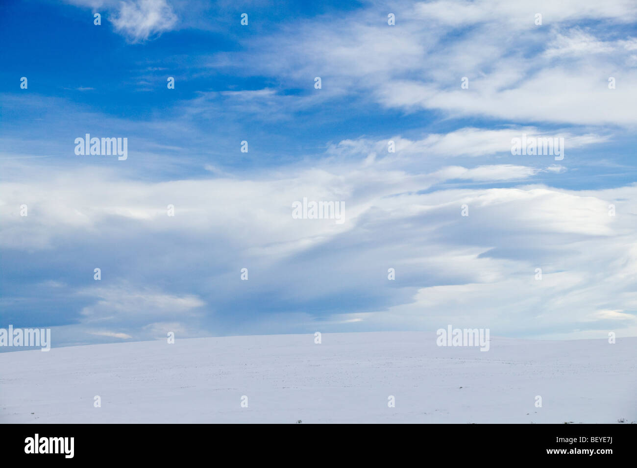 Winter landscape of clouds, snow & ranch fields near Fairplay, Colorado, USA - Stock Image