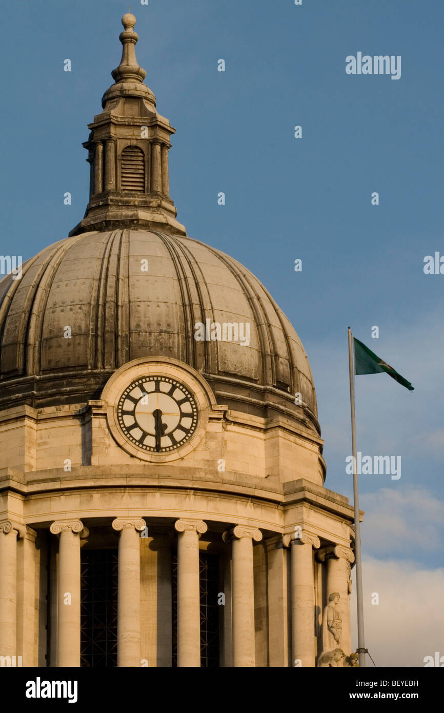 The clock on the Nottingham Council House with the flag at full mast to indicate the mayor or sheriff is in residence. - Stock Image