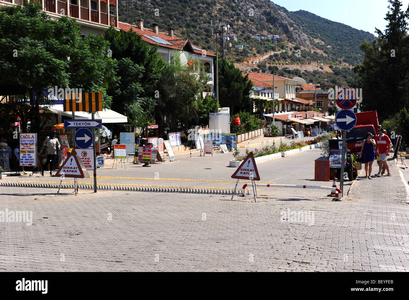 One of  the main roads going through Kalkan with a stinger to stop cars entering - Stock Image