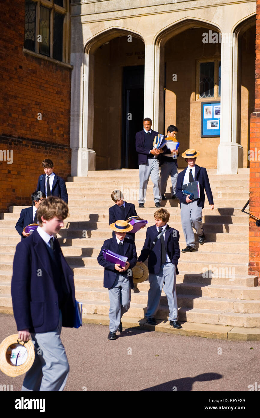 Harrow on the Hill , Harrow School pupils or students in uniform walking in grounds with traditional straw boaters - Stock Image