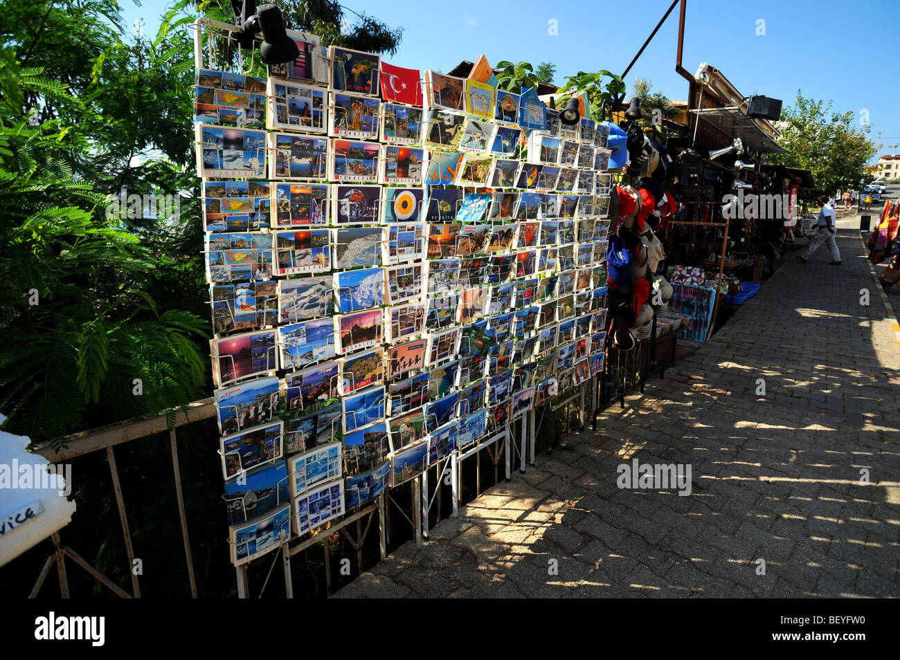 Rows of postcards on sale outside a shop in kalkan - Stock Image