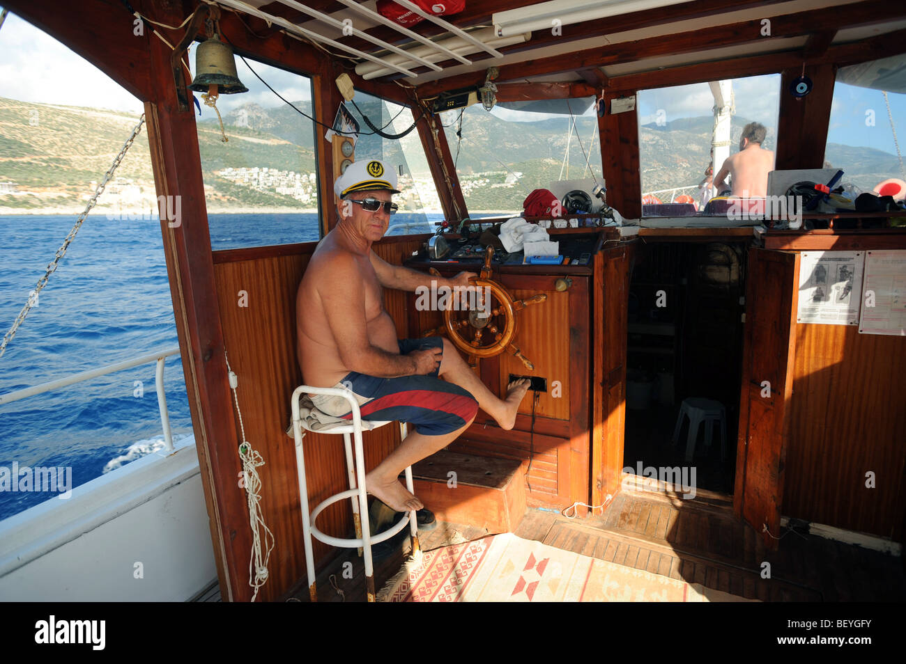 Captain of a pleasure cruise boat for tourists round the bay of Kalkan - Stock Image