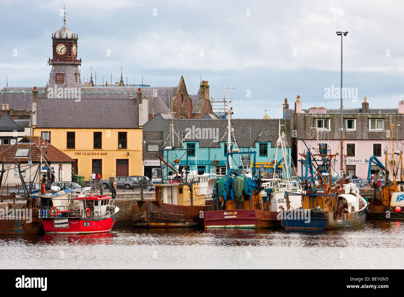 Fishing boats in the natural harbour of Stornoway on the Isle of Lewis, Scotland - Stock Image